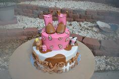 Girl cowgirl baby shower cake    http://www.modern-baby-shower-ideas.com/cowgirl-baby-shower.html