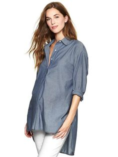 Gorgeous chambray button down.  Its longer style makes it perfect to layer over leggings or skinnies.