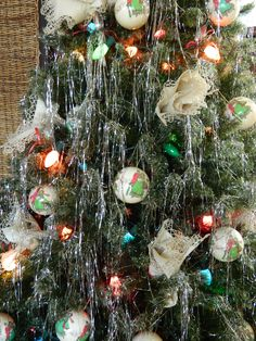 Christmas tree decorated with antique silver spoons and napkins.