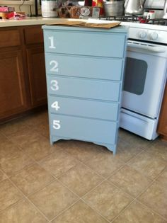 Old small dresser that I have a facelift to. The numbers and paint give it a beachy feel. I added rope pulls( not pictured) after I couldn't open the drawers.
