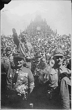 Hitler at Nazi party rally Note the Church of our Lady in the background. Photo taken in Nuremberg, Germany (circa 1928). [Posted at 20th Century History, from US Holocaust Museum]