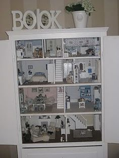 I'd like to hinge together 2 bookcases so they can open/close it.  Decorate the outside...Cut out some windows.  :)