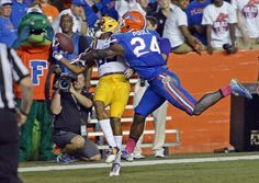 Advocate staff photo by BILL FEIG -- LSU wide receiver Travin Dural (83) pulls in the touchdown pass in spite of the pass interference by Florida defensive back Brian Poole (24) during the second half of the teams' game Saturday, Oct. 11, 2014 in Gainesville. LSU won 30-27.