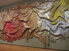 Gravity & Grace at the Akron Art Museum. The artist, El Anatsui creates his sculptures using bottle caps that are tied together loosely with wires. These sculptures are  similar to large pieces of fabric. I loved the fact that every time they are placed in a gallery they are hung differently. 'The idea of a sheet that you can shape and reshape...all that fluidity is behind the concept.'