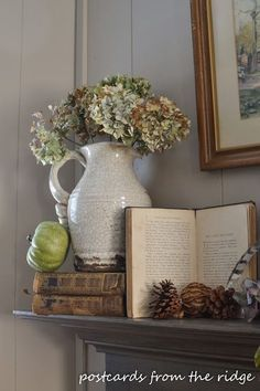 How to Decorate a Fall Mantel With Vintage and Found Items. Not sure about the little leaning green gourd, but love the idea of opening a favorite book to favorite scene or illustration...nice!