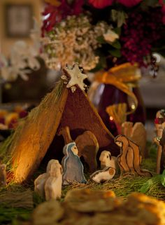 Details of the handmade gingerbread manger at Green Palm Inn for the Christmas holiday. Wheat berry grass is the greenery.  Photo (c) 2011 Green Palm Inn / Adam Kuehl.