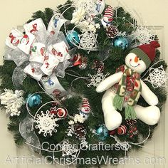 "Snowman Wreath - 2013 - Our 'Snowman' Christmas Wreath will add a touch of ""Frosty"" charm to any home. - #ArtificialChristmasWreaths #SnowmanWreath #WinterWreath #ChristmasWreaths #Wreaths #Wreath"