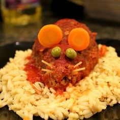 "Halloween Bloody Baked Rats | ""This is a fun, inexpensive, creepy Halloween entree that will gross out and impress your dinner guests. It is mini meatloaves baked in tomato sauce that are shaped like rats with cheese in the middle. When you cut it open, gooey cheese will come oozing out. Garnished with a spaghetti noodle tail and carrot ears, these pests are sure to be a devilishly delectable dinner."