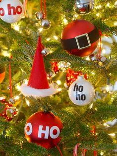 Red Hat Ornaments: Tiny hats and ho ho ho ornaments made with stick-on letters keep the tannenbaum on theme. #christmas #holiday #crafts