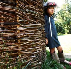 Wattle (woven twigs) fencing can be DIY. Good temporary fencing.