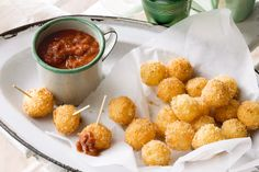 Creamy bocconcini is golden fried for an enticing crunch, and served with a spicy tomato dip.