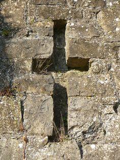 cross in a wall