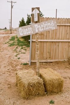 Talk about #rustic! Barrels of hay to hold up #signs...adorable! {Lissa Anglin Photography} barn weddings, wedding rustic, wedding photos, rustic weddings