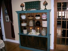 This was an old cupboard that needed repair. I left most of the wood it's weathered look, but highlighted sections with Old Village Paint Cupboard Blue. Edward Bozenski