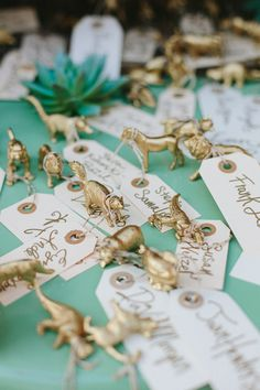 animal figurine escort cards // photo by Kate Miller Photography // http://ruffledblog.com/whimsical-illinois-barn-wedding