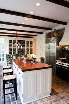 love the brick flooring and the butcher block counter tops.