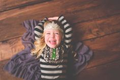 She looks like she is tickled pink!  Little Ones - Jenn Harvey Photography