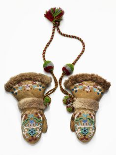 Gwich'in (Kutchin), Yukon River, Alaska. Mittens. 1907-1913. Moose hind/skin, wool cloth, beaver skin/fur, glass beads, metal beads, wool yarn, sinew.. sew, overlay beadwork, edge beaded braided
