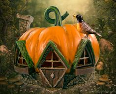 Pumpkin Fairy House with a little robin in the fairy garden.