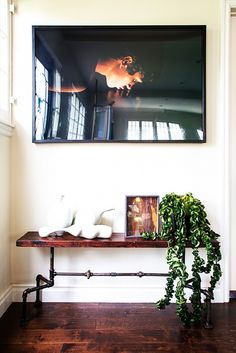 Entryway with large photography and industrial style bench