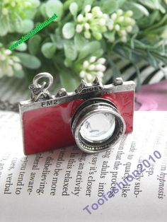 Pretty retro silver red camera with glass lens by toofashion2010, $2.85