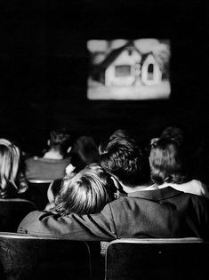 At the movies by Nina Leen, 1944. #vintage #1940s #couples #photography