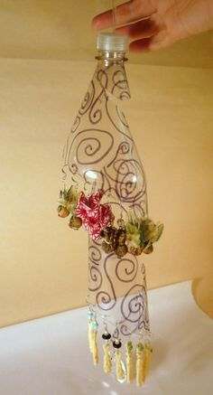 soda-bottle-earring-display. Maybe stencil paint the bottle before cutting it into a spiral...has possibilities.