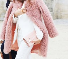LE FASHION BLOG PINK STYLE TAO STREET STYLE FUZZY CURLY FUR PINK COAT WHITE SUIT LIGHT PINK CLUTCH BAG PARIS FASHION WEEK photo LEFASHIONBLO...