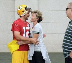 Green Bay Packers quarterback Aaron Rodgers hugs his mother Darla Rodgers before taking the field during training camp practice at Ray Nitschke Field on Friday, July 26, 2013.