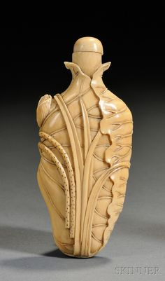Ivory Snuff Bottle, China, early 20th century, the flattened ovoid body with relief carving of lotus leaves and flowers, with stopper, lg. 3 3/8 in.