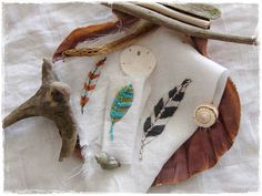 """hand embroidered feathers for """"the magic feather project"""""""