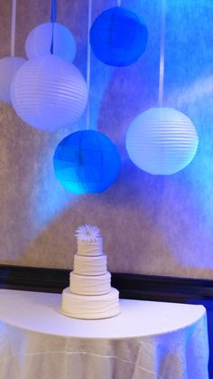 Lanterns over the Wedding Cake. It a real Wedding at the Embassy Suites Airport.  (Bloomington MN)