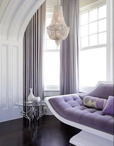 Beautiful - Lavender touches with white & glass accents like the chandelier and vases add to this beauty of this room.