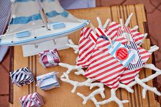 Striped treat bags, perfect for guests to take home leftover desserts. #party #favors #babyshower