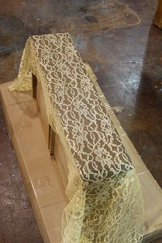 Put lace over drawer, spray paint and remove lace
