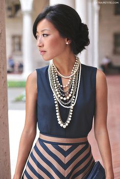 Pearl strands dress up a standard office outfit.