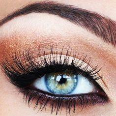 Copper & black eye makeup...blue eyes pop.