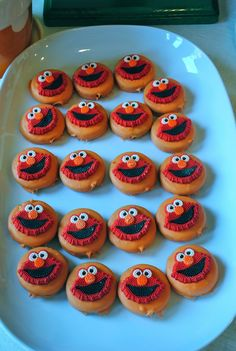 Sesame street party chocolate covered Oreos with Elmo sugars on top