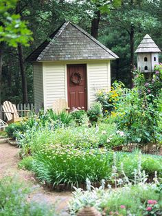 Pretty garden shed and love the bird house next to it
