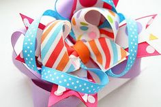 I really liked this boutique bow tutorial...it gives you the base for the crazy layered bows.