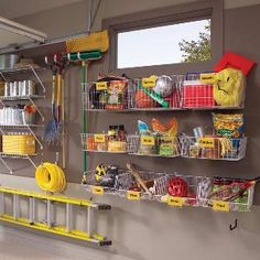 Organizing the garage using mounted baskets.  The garage is one of our favorite places to use vertical space!