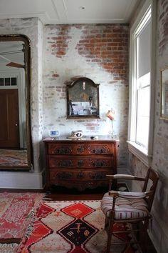 exposed brick wall finish decor, interior design, house design, design homes, rug, antique furniture, cozy spaces, exposed brick, bedroom