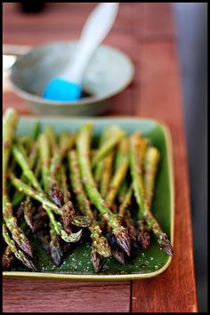 Garlic Roasted Asparagus - Toss asparagus with olive oil, salt, pepper, and garlic powder. Bake at 350 degrees for 15 minutes.