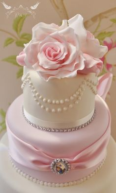 Romeo & Juliet Cakes - Francesca ivory and pink wedding cake with pink sugar roses and pearl necklace, diamond brooch, diamantes and large bow