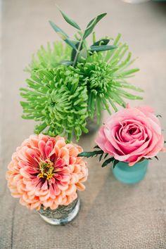 a mini collection of flowers  - photo by Matt Edge - http://ruffledblog.com/southern-inspired-wedding/