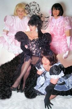 Madam Raison Detre and her sissy maids