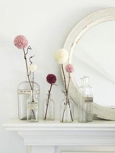 mirror, pom poms, valentine day crafts, vintage bottles, mantel, fresh flowers, yarn, mantl, old bottles