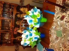 I made two flower arrangements with newborn diapers.