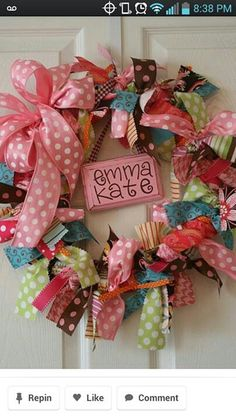 What a cute idea for a wreath door décor for girls room.  How easy to make too.