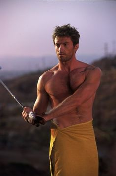 Who am I to ask why Hugh Jackman would be playing golf in a towel?